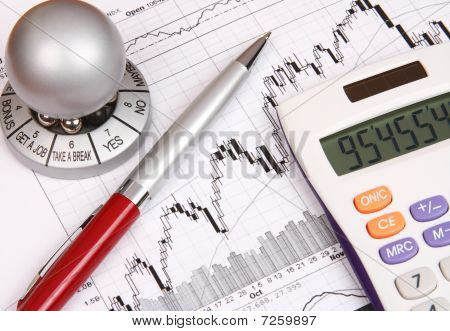 Financial Chart With A Souvenir And A Red Pen