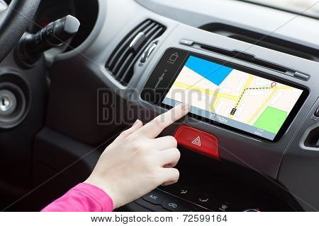 Woman Sitting In A Car And Touch Play Finger In A Navigation Map
