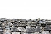 foto of old stone fence  - Detail of and old stone wall isolated on white background - JPG