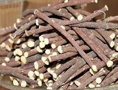 stock photo of licorice  - pure licorice sticks for sale at the market