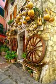 picture of wagon wheel  - Pumpkins and gold wagon wheels decorating a Tuscan house - JPG