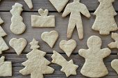 stock photo of ginger bread  - Ginger Bread Texture on Wooden Plank Cookies Background - JPG