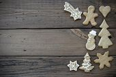 picture of ginger bread  - Decorated Ginger Bread Cookies on Wood with Copy Space for Your Text - JPG