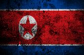 pic of communist symbol  - grunge flag of North Korea with capital in Pyongyang - JPG