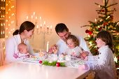 pic of little young child children girl toddler  - Big happy young family with three children enjoying Christmas dinner celebration parents and kids  - JPG