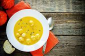 stock photo of meatball  - pumpkin soup with meatballs on a dark wood background - JPG