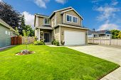 image of driveway  - Two story house exterior with white door garage and driveway  - JPG