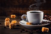 stock photo of sugar cube  - Cup of coffee in the old rustic style with cane sugar cubes and coffee beans - JPG