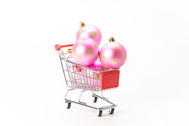 foto of caddy  - Caddy for shopping with christmas ball on white background - JPG
