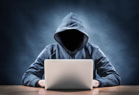 stock photo of spyware  - picture of a hacker on a computer - JPG
