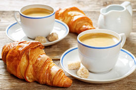 foto of continental food  - fresh Breakfast with croissants espresso and milk on a dark wood background - JPG