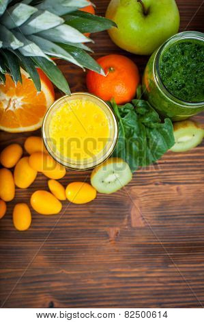 Blended Green And Yellow Smoothie With Ingredients