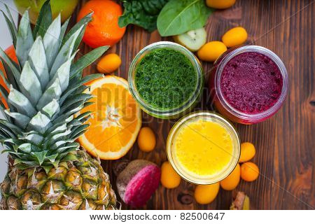 Blended Green,yellow And Purple Smoothie With Ingredients
