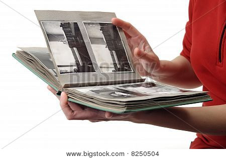 Woman looking in old photo album