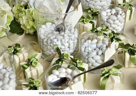 White Sugared Almonds On Glasses And Gift Boxes