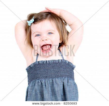 "Cute toddler girl shouting ""hooray!"""