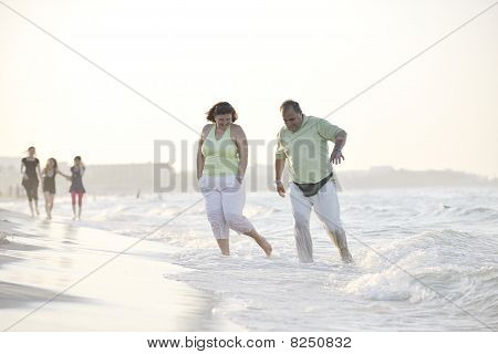 Happy Seniors Couple  On Beach