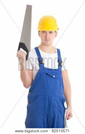 Man In Builder Uniform And Helmet With Manual Saw Isolated On White