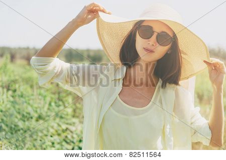 Beautiful Woman Resting In Summer Park
