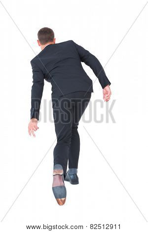 Businessman putting hand down on white background