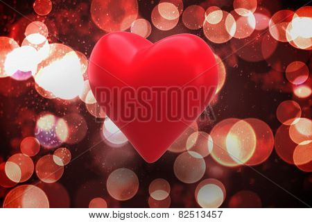 Red heart against twinkling red and orange lights