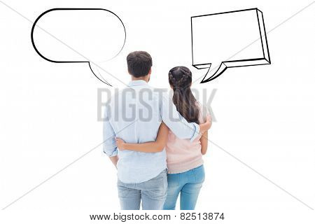 Attractive young couple standing with arms around against speech bubble