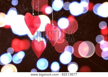 Love hearts against twinkling red and blue lights