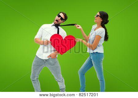Brunette pulling her boyfriend by the tie against green vignette