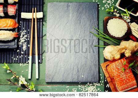 Asian food background (sushi and ingredients)