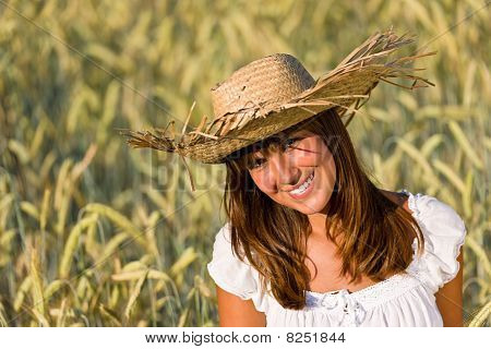 Happy Woman With Straw Hat In Corn Field