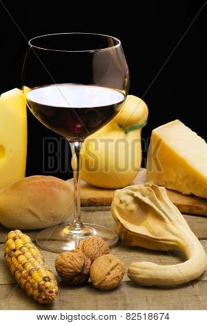 Red Wine With Cheese Selection With Autumnal Decoration