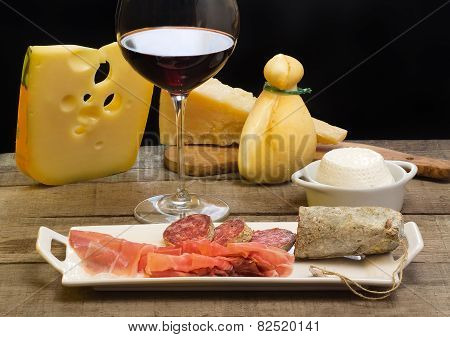 Selection Of Dairy Product, Salami, Parma Ham  And Red Wine