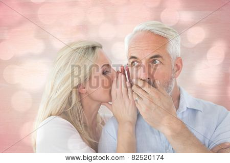 Woman whispering a secret to husband against light circles on grey background