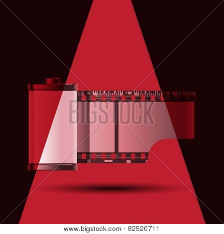reel of 35 mm photo film with red light