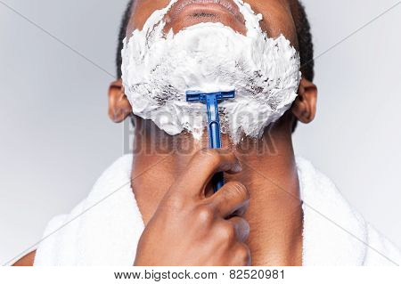 Close Up Of Man Shaving.