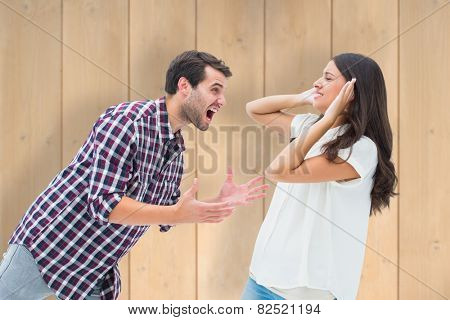 Fearful brunette being overpowered by boyfriend against wooden planks