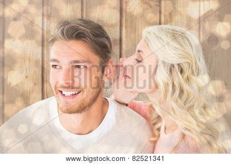 Attractive blonde whispering secret to boyfriend against light glowing dots design pattern