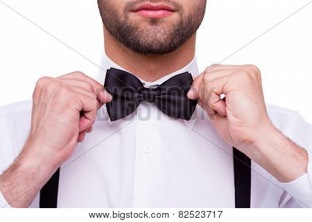 Man Adjusting Bow Tie.