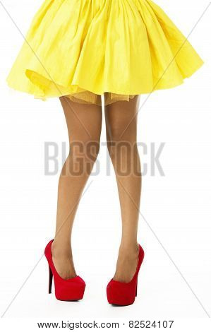Closeup of Beautiful Legs of African Model, Wearing Yellow Skirt and Red Shoes