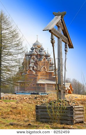 Cross before Wooden orthodox church in name of Cover All-holy mother of God Russia (Pokrovskaya chur