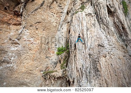 Young Female Rock Climber On Incredible Wall, Railay Beach In Thailand.