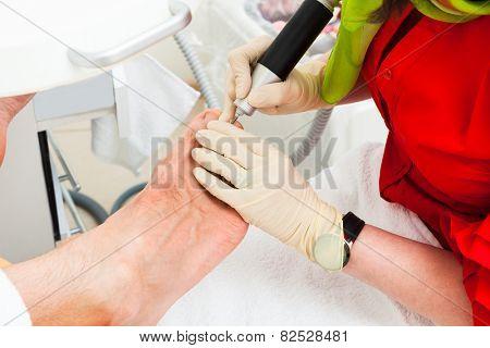 pedicures man in modern beauty salon