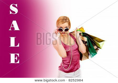 Young Pretty Shopping Woman With Lots Of Bags And Sale Word