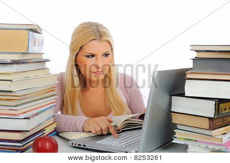 Portrait Of Young Student Woman With Lots Of Books And Laptop Studing For Exams. Isolated On White B