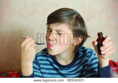 Preteen Handsome Boy Make A Grimace After Taking Bitter Medicine