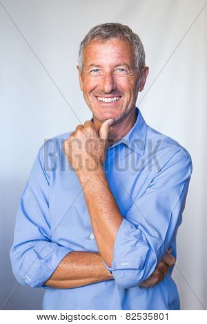 Portrait of a smiling successful mature handsome man