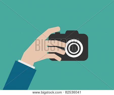 hand holding camera flat icon