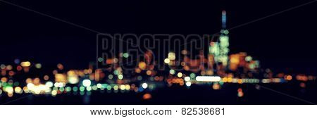 New York City downtown skyline out of focus bokeh panorama at night