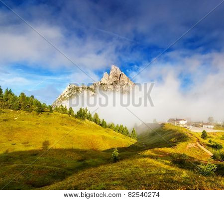 Great view of the foggy Mt. Sass de Stria from Falzarego pass. National Park. Dolomites (Dolomiti), South Tyrol. Location Cortina d'Ampezzo. Italy, Europe. Dramatic scene. Beauty world.