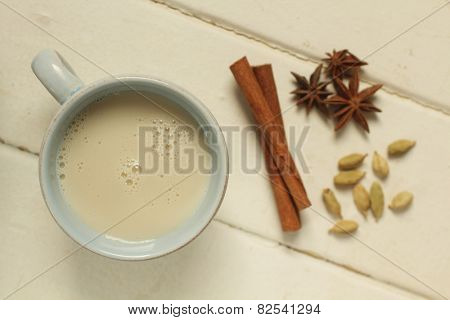 Top view of a chai tea with cinnamon, anise and cardamom